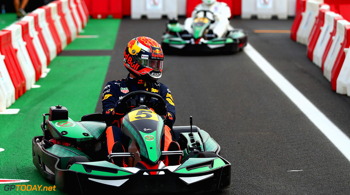 MONZA, ITALY - AUGUST 31:  Max Verstappen of Netherlands and Red Bull Racing competes with Dida at a karting event during previews for the Formula One Grand Prix of Italy at Autodromo di Monza on August 31, 2017 in Monza, Italy.  (Photo by Clive Rose/Getty Images) // Getty Images / Red Bull Content Pool  // P-20170831-12759 // Usage for editorial use only // Please go to www.redbullcontentpool.com for further information. //  F1 Grand Prix of Italy - Previews Clive Rose Monza Italy  P-20170831-12759