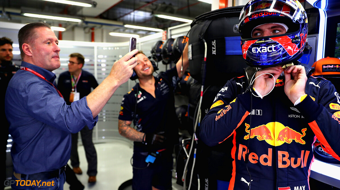 SINGAPORE - SEPTEMBER 15: Max Verstappen of Netherlands and Red Bull Racing prepares to drive as his father Jos Verstappen takes a photo during practice for the Formula One Grand Prix of Singapore at Marina Bay Street Circuit on September 15, 2017 in Singapore.  (Photo by Mark Thompson/Getty Images) // Getty Images / Red Bull Content Pool  // P-20170915-00563 // Usage for editorial use only // Please go to www.redbullcontentpool.com for further information. //  F1 Grand Prix of Singapore - Practice Mark Thompson Singapore Singapore  P-20170915-00563