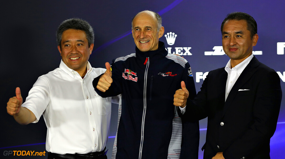 SINGAPORE - SEPTEMBER 15:  Scuderia Toro Rosso Team Principal Franz Tost with Katsuhide Moriyama and Masashi Yamamoto, both of Honda, in a press conference to announce the partnership between Honda and Scuderia Toro Rosso for the 2018 F1 season onward after practice for the Formula One Grand Prix of Singapore at Marina Bay Street Circuit on September 15, 2017 in Singapore.  (Photo by Mark Thompson/Getty Images) // Getty Images / Red Bull Content Pool  // P-20170915-01303 // Usage for editorial use only // Please go to www.redbullcontentpool.com for further information. //  F1 Grand Prix of Singapore - Practice Mark Thompson Singapore Singapore  P-20170915-01303