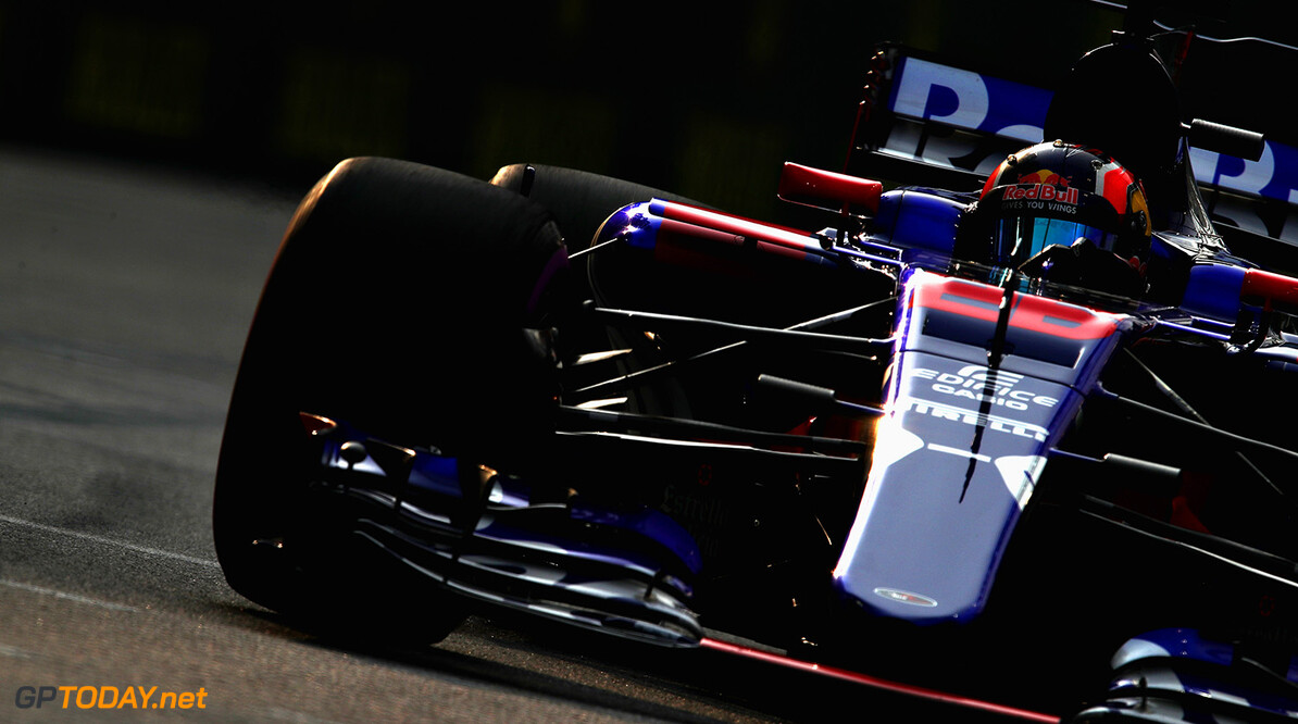 SINGAPORE - SEPTEMBER 15: Daniil Kvyat of Russia driving the (26) Scuderia Toro Rosso STR12 on track during practice for the Formula One Grand Prix of Singapore at Marina Bay Street Circuit on September 15, 2017 in Singapore.  (Photo by Clive Mason/Getty Images) // Getty Images / Red Bull Content Pool  // P-20170915-00402 // Usage for editorial use only // Please go to www.redbullcontentpool.com for further information. //  F1 Grand Prix of Singapore - Practice Clive Mason Singapore Singapore  P-20170915-00402