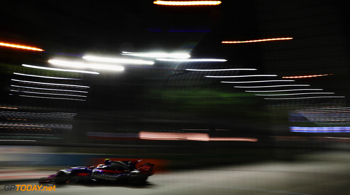 SINGAPORE - SEPTEMBER 15: Carlos Sainz of Spain driving the (55) Scuderia Toro Rosso STR12 on track during practice for the Formula One Grand Prix of Singapore at Marina Bay Street Circuit on September 15, 2017 in Singapore.  (Photo by Mark Thompson/Getty Images) // Getty Images / Red Bull Content Pool  // P-20170915-01344 // Usage for editorial use only // Please go to www.redbullcontentpool.com for further information. //  F1 Grand Prix of Singapore - Practice Mark Thompson Singapore Singapore  P-20170915-01344