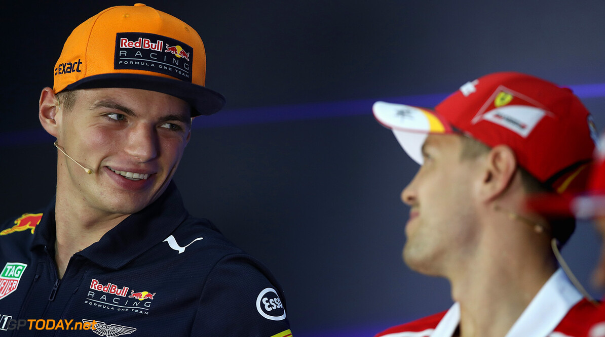 KUALA LUMPUR, MALAYSIA - SEPTEMBER 28: Max Verstappen of Netherlands and Red Bull Racing talks with Sebastian Vettel of Germany and Ferrari in the Drivers Press Conference during previews for the Malaysia Formula One Grand Prix at Sepang Circuit on September 28, 2017 in Kuala Lumpur, Malaysia.  (Photo by Clive Mason/Getty Images) // Getty Images / Red Bull Content Pool  // P-20170928-00391 // Usage for editorial use only // Please go to www.redbullcontentpool.com for further information. //  F1 Grand Prix of Malaysia - Previews Clive Mason Sepang Malaysia  P-20170928-00391