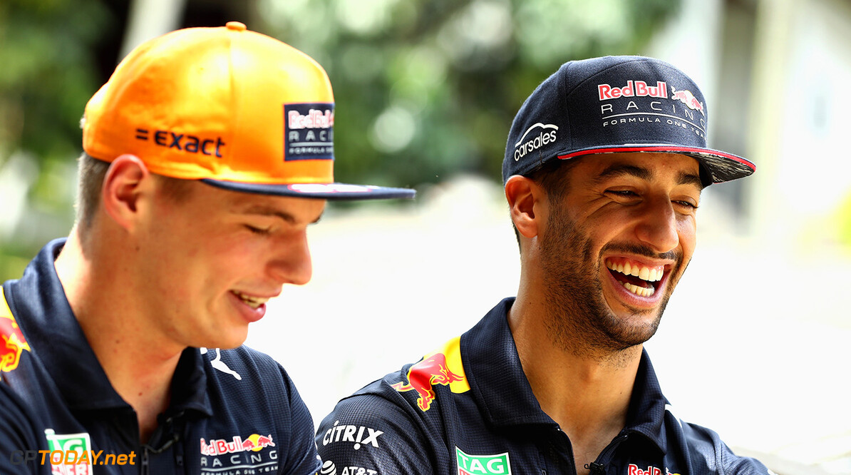 KUALA LUMPUR, MALAYSIA - SEPTEMBER 28:  Daniel Ricciardo of Australia and Red Bull Racing and Max Verstappen of Netherlands and Red Bull Racing talk during previews for the Malaysia Formula One Grand Prix at Sepang Circuit on September 28, 2017 in Kuala Lumpur, Malaysia.  (Photo by Mark Thompson/Getty Images) // Getty Images / Red Bull Content Pool  // P-20170928-00131 // Usage for editorial use only // Please go to www.redbullcontentpool.com for further information. //  F1 Grand Prix of Malaysia - Previews Mark Thompson Sepang Malaysia  P-20170928-00131