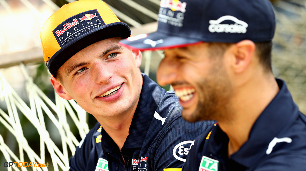 KUALA LUMPUR, MALAYSIA - SEPTEMBER 28:  Daniel Ricciardo of Australia and Red Bull Racing and Max Verstappen of Netherlands and Red Bull Racing talk during previews for the Malaysia Formula One Grand Prix at Sepang Circuit on September 28, 2017 in Kuala Lumpur, Malaysia.  (Photo by Mark Thompson/Getty Images) // Getty Images / Red Bull Content Pool  // P-20170928-00119 // Usage for editorial use only // Please go to www.redbullcontentpool.com for further information. //  F1 Grand Prix of Malaysia - Previews Mark Thompson Sepang Malaysia  P-20170928-00119