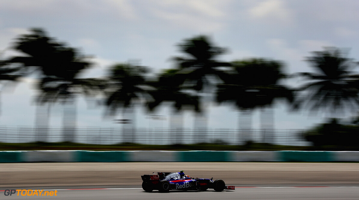 KUALA LUMPUR, MALAYSIA - SEPTEMBER 29: Carlos Sainz of Spain driving the (55) Scuderia Toro Rosso STR12 on track during practice for the Malaysia Formula One Grand Prix at Sepang Circuit on September 29, 2017 in Kuala Lumpur, Malaysia.  (Photo by Clive Mason/Getty Images) // Getty Images / Red Bull Content Pool  // P-20170929-00788 // Usage for editorial use only // Please go to www.redbullcontentpool.com for further information. //  F1 Grand Prix of Malaysia - Practice Clive Mason Sepang Malaysia  P-20170929-00788
