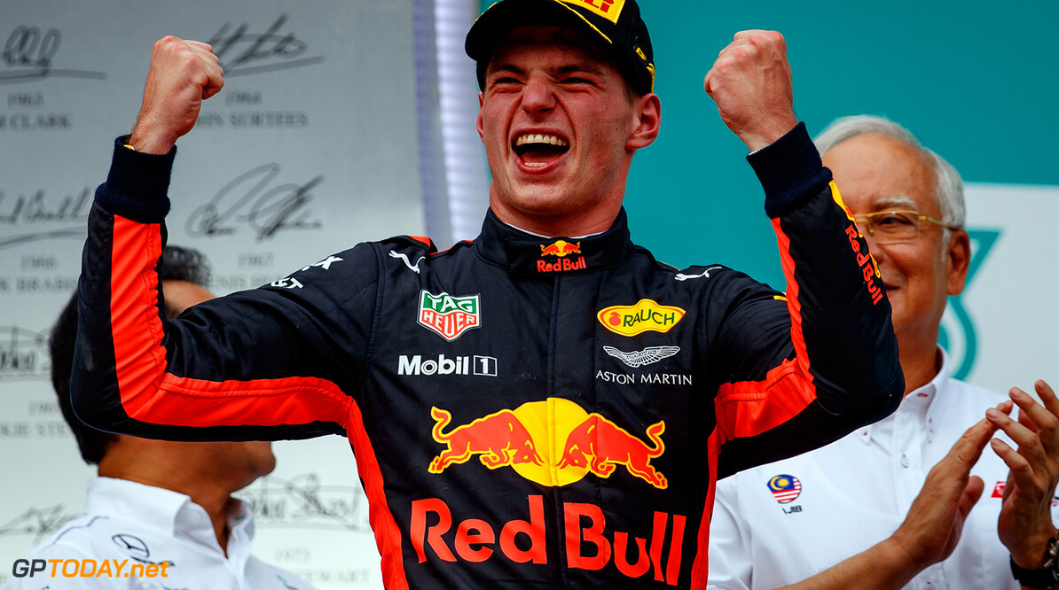 KUALA LUMPUR, MALAYSIA - OCTOBER 01:  Race winner Max Verstappen of Netherlands and Red Bull Racing celebrates on the podium during the Malaysia Formula One Grand Prix at Sepang Circuit on October 1, 2017 in Kuala Lumpur, Malaysia.  (Photo by Lars Baron/Getty Images) // Getty Images / Red Bull Content Pool  // P-20171001-00551 // Usage for editorial use only // Please go to www.redbullcontentpool.com for further information. //  F1 Grand Prix of Malaysia  Sepang Malaysia  P-20171001-00551