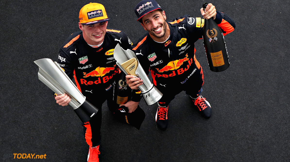 KUALA LUMPUR, MALAYSIA - OCTOBER 01:  Race winner Max Verstappen of Netherlands and Red Bull Racing celebrates with third place finisher Daniel Ricciardo of Australia and Red Bull Racing on the podium during the Malaysia Formula One Grand Prix at Sepang Circuit on October 1, 2017 in Kuala Lumpur, Malaysia.  (Photo by Mark Thompson/Getty Images) // Getty Images / Red Bull Content Pool  // P-20171001-00545 // Usage for editorial use only // Please go to www.redbullcontentpool.com for further information. //  F1 Grand Prix of Malaysia Mark Thompson Sepang Malaysia  P-20171001-00545