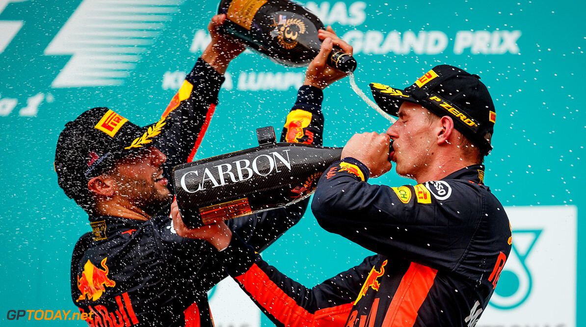 KUALA LUMPUR, MALAYSIA - OCTOBER 01:  Race winner Max Verstappen of Netherlands and Red Bull Racing celebrates with third place finisher Daniel Ricciardo of Australia and Red Bull Racing on the podium during the Malaysia Formula One Grand Prix at Sepang Circuit on October 1, 2017 in Kuala Lumpur, Malaysia.  (Photo by Lars Baron/Getty Images) // Getty Images / Red Bull Content Pool  // P-20171001-00539 // Usage for editorial use only // Please go to www.redbullcontentpool.com for further information. //  F1 Grand Prix of Malaysia     P-20171001-00539
