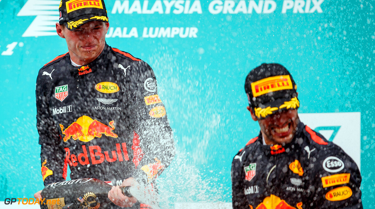 KUALA LUMPUR, MALAYSIA - OCTOBER 01:  Race winner Max Verstappen of Netherlands and Red Bull Racing celebrates with third place finisher Daniel Ricciardo of Australia and Red Bull Racing on the podium during the Malaysia Formula One Grand Prix at Sepang Circuit on October 1, 2017 in Kuala Lumpur, Malaysia.  (Photo by Lars Baron/Getty Images) // Getty Images / Red Bull Content Pool  // P-20171001-00614 // Usage for editorial use only // Please go to www.redbullcontentpool.com for further information. //  F1 Grand Prix of Malaysia  Sepang Malaysia  P-20171001-00614
