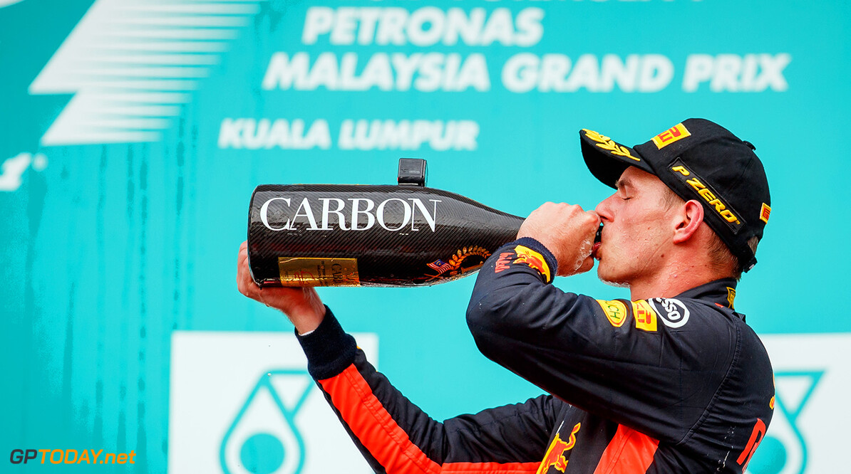 KUALA LUMPUR, MALAYSIA - OCTOBER 01:  Race winner Max Verstappen of Netherlands and Red Bull Racing celebrates on the podium during the Malaysia Formula One Grand Prix at Sepang Circuit on October 1, 2017 in Kuala Lumpur, Malaysia.  (Photo by Lars Baron/Getty Images) // Getty Images / Red Bull Content Pool  // P-20171001-00629 // Usage for editorial use only // Please go to www.redbullcontentpool.com for further information. //  F1 Grand Prix of Malaysia  Sepang Malaysia  P-20171001-00629