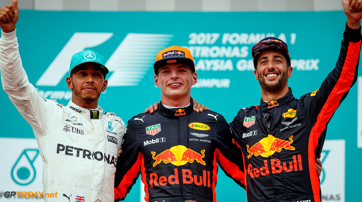 KUALA LUMPUR, MALAYSIA - OCTOBER 01:  Race winner Max Verstappen of Netherlands and Red Bull Racing, second place finisher Lewis Hamilton of Great Britain and Mercedes GP and third place finisher Daniel Ricciardo of Australia and Red Bull Racing celebrate on the podium during the Malaysia Formula One Grand Prix at Sepang Circuit on October 1, 2017 in Kuala Lumpur, Malaysia.  (Photo by Lars Baron/Getty Images) // Getty Images / Red Bull Content Pool  // P-20171001-00647 // Usage for editorial use only // Please go to www.redbullcontentpool.com for further information. //  F1 Grand Prix of Malaysia  Sepang Malaysia  P-20171001-00647