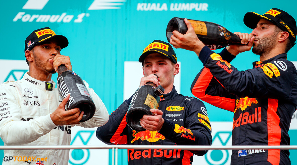 KUALA LUMPUR, MALAYSIA - OCTOBER 01: Race winner Max Verstappen of Netherlands and Red Bull Racing, second place finisher Lewis Hamilton of Great Britain and Mercedes GP and third place finisher Daniel Ricciardo of Australia and Red Bull Racing celebrate on the podium during the Malaysia Formula One Grand Prix at Sepang Circuit on October 1, 2017 in Kuala Lumpur, Malaysia.  (Photo by Lars Baron/Getty Images) // Getty Images / Red Bull Content Pool  // P-20171001-00644 // Usage for editorial use only // Please go to www.redbullcontentpool.com for further information. //  F1 Grand Prix of Malaysia  Sepang Malaysia  P-20171001-00644