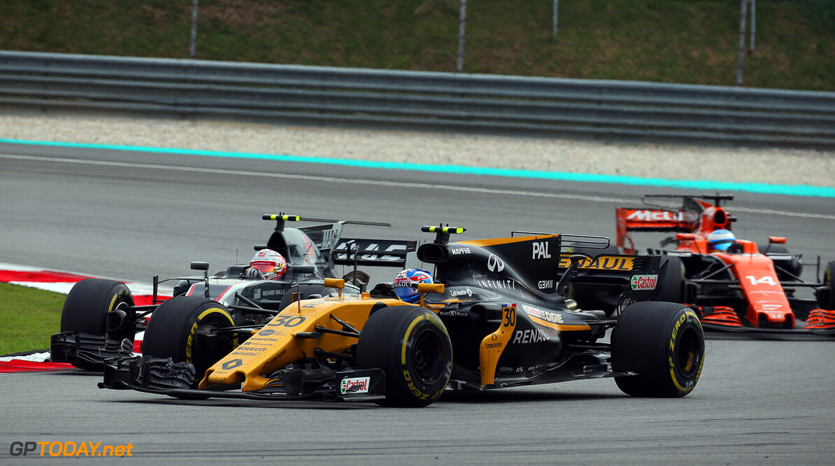 Formula One World Championship Jolyon Palmer (GBR) Renault Sport F1 Team RS17 and Kevin Magnussen (DEN) Haas VF-17 battle for position. Malaysian Grand Prix, Sunday 1st October 2017. Sepang, Kuala Lumpur, Malaysia. Motor Racing - Formula One World Championship - Malaysian Grand Prix - Race Day - Sepang, Malaysia Renault Sport Formula One Team Sepang Malaysia  Formula One Formula 1 F1 GP Grand Prix Kuala Lumpur Sepang Malaysia Malaysian JM765 Sepang International Circuit Action Track GP1715d