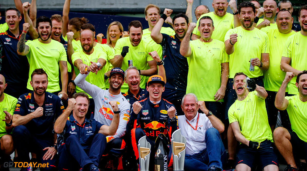 KUALA LUMPUR, MALAYSIA - OCTOBER 01:  Race winner Max Verstappen of Netherlands and Red Bull Racing, third place finisher Daniel Ricciardo of Australia and Red Bull Racing, Red Bull Racing Team Principal Christian Horner, Red Bull Racing Team Consultant Dr Helmut Marko and the rest of the Red Bull Racing team celebrate after the Malaysia Formula One Grand Prix at Sepang Circuit on October 1, 2017 in Kuala Lumpur, Malaysia.  (Photo by Lars Baron/Getty Images) // Getty Images / Red Bull Content Pool  // P-20171001-00845 // Usage for editorial use only // Please go to www.redbullcontentpool.com for further information. //  F1 Grand Prix of Malaysia  Sepang Malaysia  P-20171001-00845