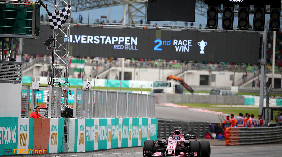 Formula One World Championship Sergio Perez (MEX) Sahara Force India F1 VJM10 takes the chequered flag at the end of the race. Malaysian Grand Prix, Sunday 1st October 2017. Sepang, Kuala Lumpur, Malaysia. Motor Racing - Formula One World Championship - Malaysian Grand Prix - Race Day - Sepang, Malaysia James Moy Photography Sepang Malaysia  Formula One Formula 1 F1 GP Grand Prix Kuala Lumpur Sepang Malaysia Malaysian JM765 Sepang International Circuit Chequered Checkered Sergio P?rez Sergio P?rez Mendoza Checo Perez Checo P?rez finish Action Track GP1715d GP1715d_M