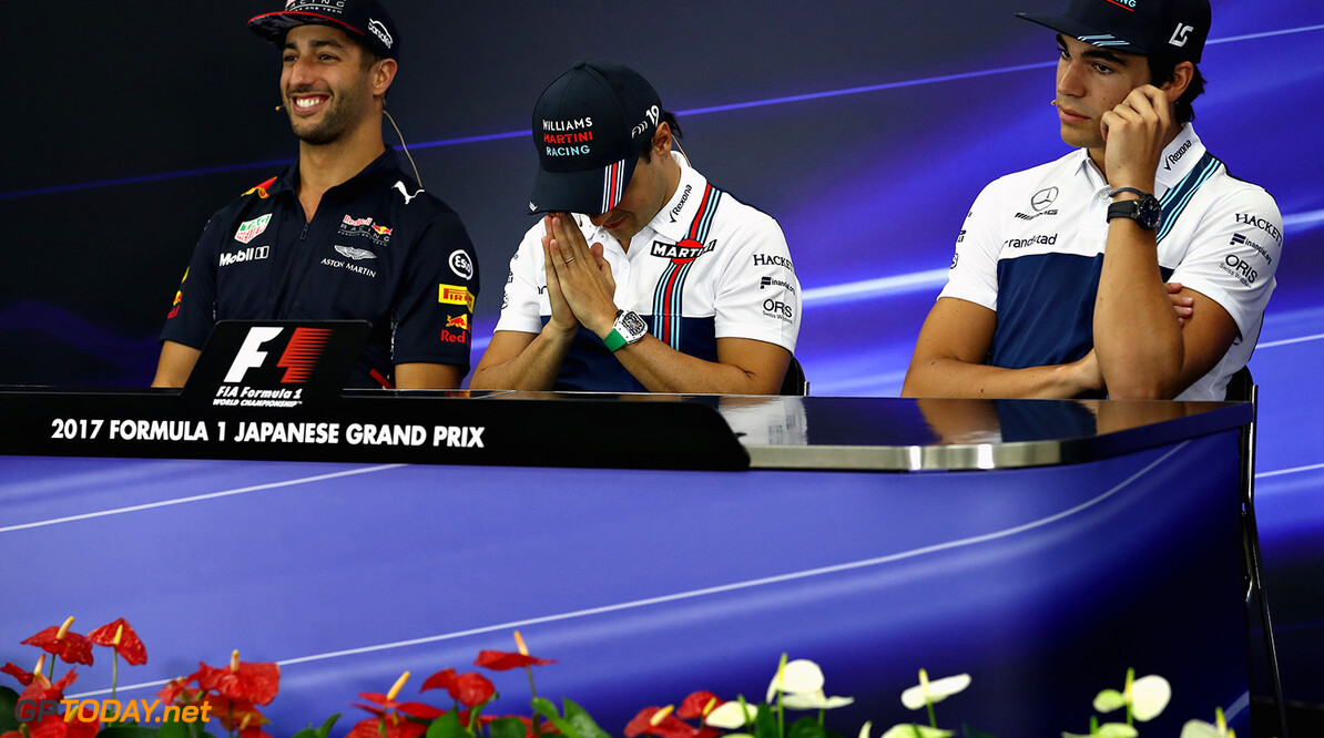 SUZUKA, JAPAN - OCTOBER 05: Daniel Ricciardo of Australia and Red Bull Racing, Felipe Massa of Brazil and Williams and Lance Stroll of Canada and Williams in the Drivers Press Conference during previews ahead of the Formula One Grand Prix of Japan at Suzuka Circuit on October 5, 2017 in Suzuka.  (Photo by Lars Baron/Getty Images) // Getty Images / Red Bull Content Pool  // P-20171005-00221 // Usage for editorial use only // Please go to www.redbullcontentpool.com for further information. //  F1 Grand Prix of Japan - Previews Lars Baron Suzuka Japan  P-20171005-00221