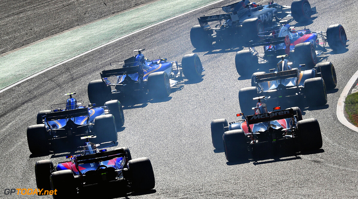 SUZUKA, JAPAN - OCTOBER 08:  Carlos Sainz of Spain driving the (55) Scuderia Toro Rosso STR12 and Fernando Alonso of Spain driving the (14) McLaren Honda Formula 1 Team McLaren MCL32 follow the field round turn one at the start during the Formula One Grand Prix of Japan at Suzuka Circuit on October 8, 2017 in Suzuka.  (Photo by Mark Thompson/Getty Images) // Getty Images / Red Bull Content Pool  // P-20171008-01286 // Usage for editorial use only // Please go to www.redbullcontentpool.com for further information. //  F1 Grand Prix of Japan Mark Thompson Suzuka Japan  P-20171008-01286