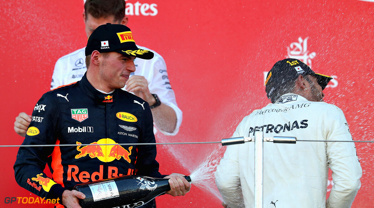 SUZUKA, JAPAN - OCTOBER 08:  Race winner Lewis Hamilton of Great Britain and Mercedes GP celebrates with second place finisher Max Verstappen of Netherlands and Red Bull Racing on the podium during the Formula One Grand Prix of Japan at Suzuka Circuit on October 8, 2017 in Suzuka.  (Photo by Mark Thompson/Getty Images) // Getty Images / Red Bull Content Pool  // P-20171008-00835 // Usage for editorial use only // Please go to www.redbullcontentpool.com for further information. //  F1 Grand Prix of Japan Mark Thompson Suzuka Japan  P-20171008-00835