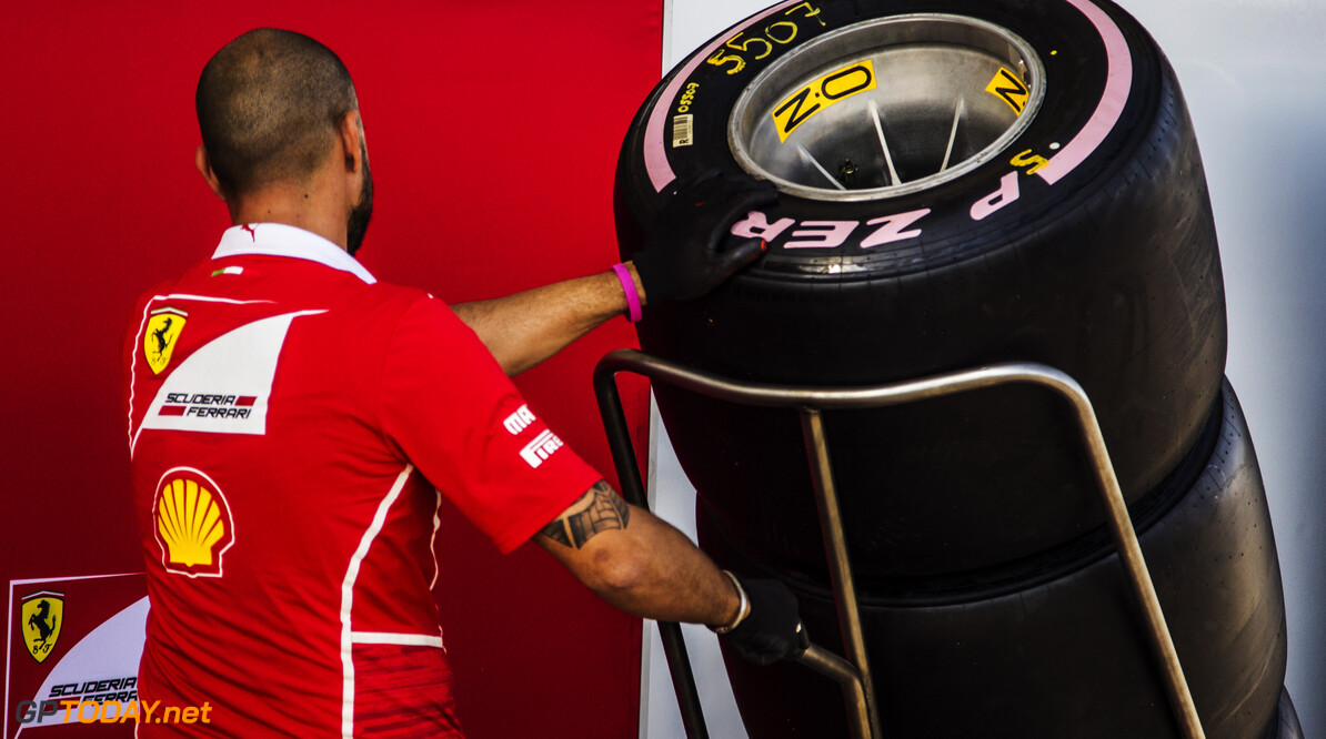 Formula One World Championship www.sutton-images.com  Ferrari mechanic and Pirelli tyres at Formula One World Championship, Rd17, United States Grand Prix, Preparations, Circuit of the Americas, Austin, Texas, USA, Thursday 19 October 2017. USA Grand Prix Preparations Manuel Goria/Sutton Images Austin USA  COTA F1 Formula 1 GP Texas portrait
