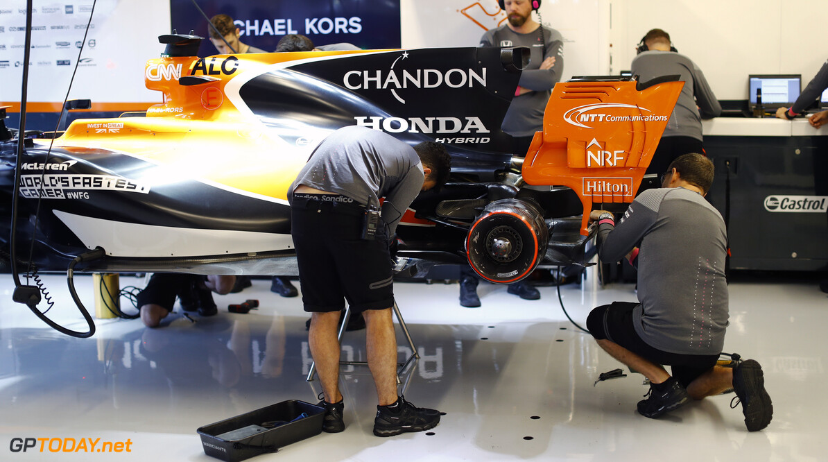 Circuit of the Americas, Austin, Texas, United States of America. Friday 20 October 2017. Engineers work on the car of Fernando Alonso, McLaren MCL32 Honda. Photo: Steven Tee/McLaren ref: Digital Image _O3I1700  Steven Tee    f1 formula 1 formula one gp grand prix Portrait