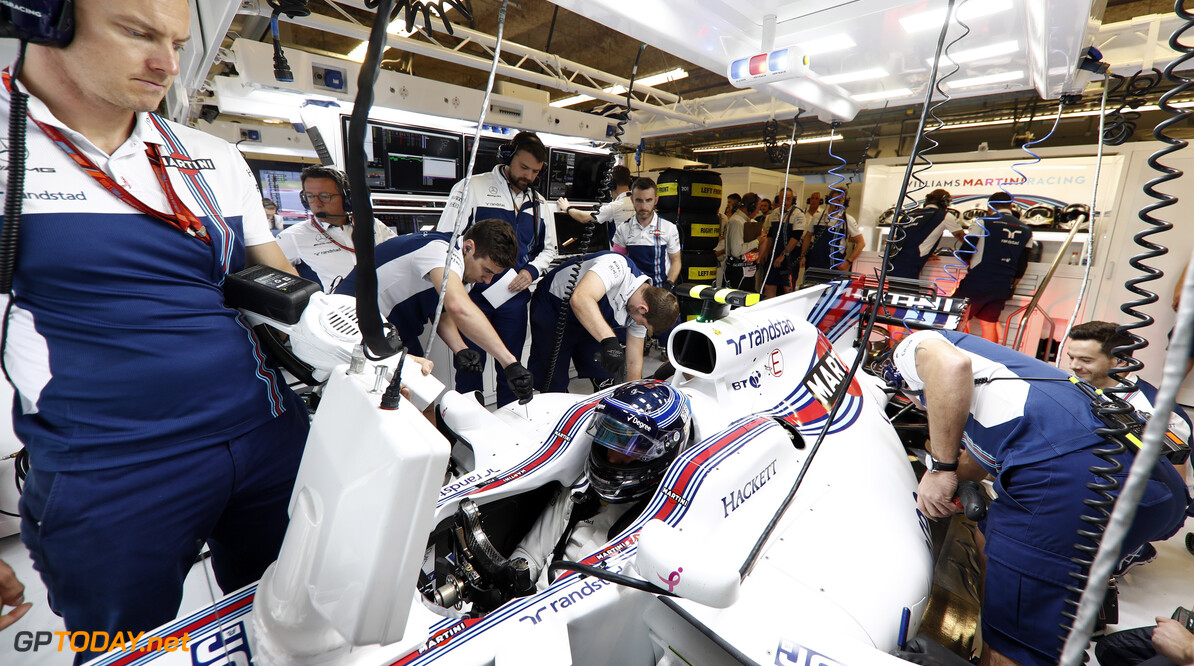 Circuit of the Americas, Austin, Texas, United States of America. Friday 20 October 2017. Lance Stroll, Williams Martini Racing, in the garage. Photo: Glenn Dunbar/Williams ref: Digital Image _X4I9261  Glenn Dunbar    f1 formula 1 formula one gp Portrait Helmets Technical