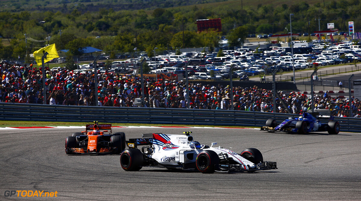 Circuit of the Americas, Austin, Texas, United States of America. Sunday 22 October 2017. Lance Stroll, Williams FW40 Mercedes, leads Stoffel Vandoorne, McLaren MCL32 Honda. Photo: Andrew Hone/Williams ref: Digital Image _ONZ8331      f1 formula 1 formula one gp Action
