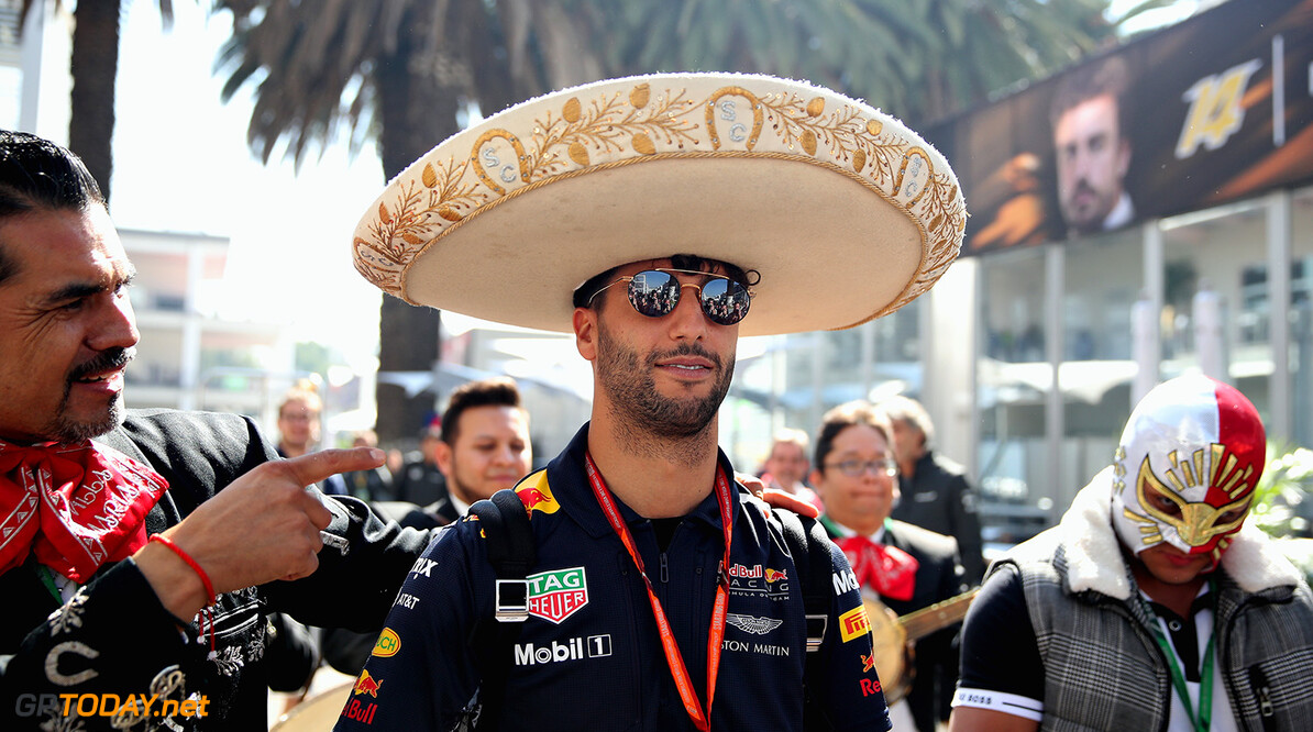 MEXICO CITY, MEXICO - OCTOBER 26:  Daniel Ricciardo of Australia and Red Bull Racing arrives at the circuit with a wrestler and a mariachi band with him during previews to the Formula One Grand Prix of Mexico at Autodromo Hermanos Rodriguez on October 26, 2017 in Mexico City, Mexico.  (Photo by Clive Mason/Getty Images) // Getty Images / Red Bull Content Pool  // P-20171026-00635 // Usage for editorial use only // Please go to www.redbullcontentpool.com for further information. //  F1 Grand Prix of Mexico - Previews Clive Mason Mexico City Mexico  P-20171026-00635