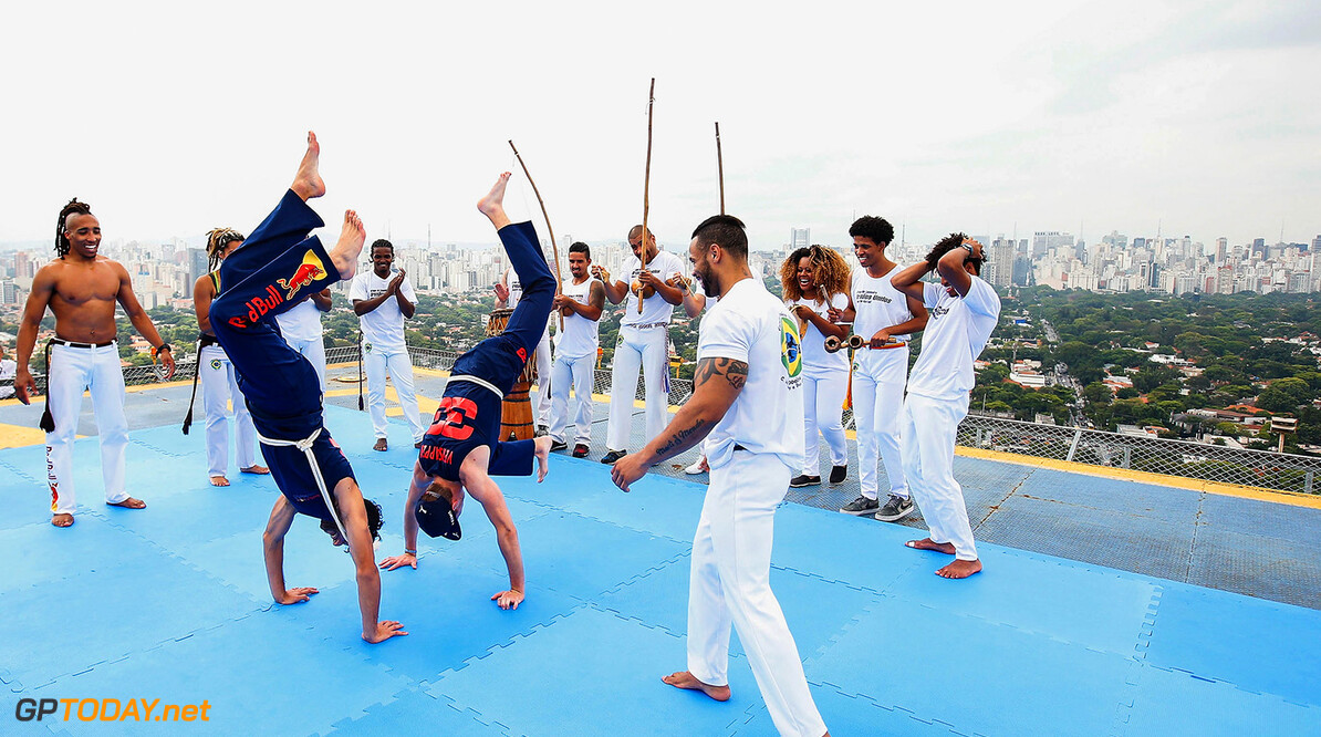 SAO PAULO, BRAZIL - NOVEMBER 08:  Max Verstappen of Netherlands and Red Bull Racing and Daniel Ricciardo of Australia and Red Bull Racing try their hand at the Brazilian martial art of Capoeira during previews for the Formula One Grand Prix of Brazil on November 8, 2017 in Sao Paulo, Brazil.  (Photo by Alexandre Schneider/Getty Images) // Getty Images / Red Bull Content Pool  // P-20171108-01336 // Usage for editorial use only // Please go to www.redbullcontentpool.com for further information. //  F1 Grand Prix of Brazil - Previews Alexandre Schneider Sao Paulo Brazil  P-20171108-01336