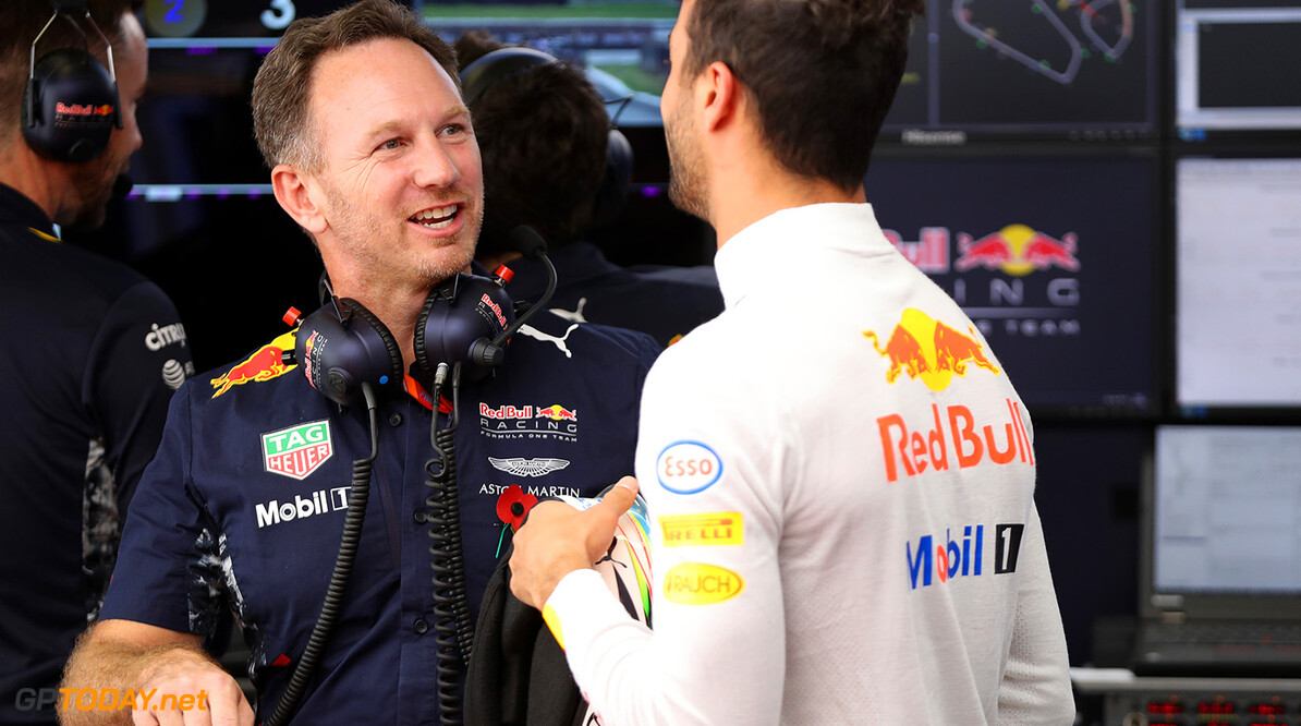 SAO PAULO, BRAZIL - NOVEMBER 10: Daniel Ricciardo of Australia and Red Bull Racing talks with Red Bull Racing Team Principal Christian Horner in the garage during practice for the Formula One Grand Prix of Brazil at Autodromo Jose Carlos Pace on November 10, 2017 in Sao Paulo, Brazil.  (Photo by Mark Thompson/Getty Images) // Getty Images / Red Bull Content Pool  // P-20171110-02092 // Usage for editorial use only // Please go to www.redbullcontentpool.com for further information. //  F1 Grand Prix of Brazil - Practice Mark Thompson Sao Paulo Brazil  P-20171110-02092
