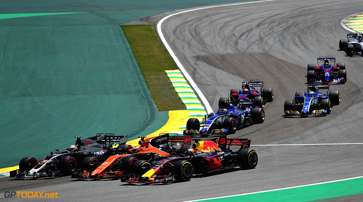 SAO PAULO, BRAZIL - NOVEMBER 12: Daniel Ricciardo of Australia driving the (3) Red Bull Racing Red Bull-TAG Heuer RB13 TAG Heuer Stoffel Vandoorne of Belgium driving the (2) McLaren Honda Formula 1 Team McLaren MCL32 and Kevin Magnussen of Denmark and Haas F1 battle into turn two at the start during the Formula One Grand Prix of Brazil at Autodromo Jose Carlos Pace on November 12, 2017 in Sao Paulo, Brazil.  (Photo by Dan Istitene/Getty Images) // Getty Images / Red Bull Content Pool  // P-20171112-00633 // Usage for editorial use only // Please go to www.redbullcontentpool.com for further information. //  F1 Grand Prix of Brazil Dan Istitene Sao Paulo Brazil  P-20171112-00633