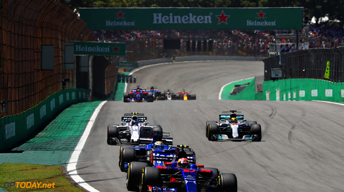 SAO PAULO, BRAZIL - NOVEMBER 12: Pierre Gasly of France and Scuderia Toro Rosso drives in the (10) Scuderia Toro Rosso STR12 leads Marcus Ericsson of Sweden driving the (9) Sauber F1 Team Sauber C36 Ferrari on track during the Formula One Grand Prix of Brazil at Autodromo Jose Carlos Pace on November 12, 2017 in Sao Paulo, Brazil.  (Photo by Mark Thompson/Getty Images) // Getty Images / Red Bull Content Pool  // P-20171112-00851 // Usage for editorial use only // Please go to www.redbullcontentpool.com for further information. //  F1 Grand Prix of Brazil Mark Thompson Sao Paulo Brazil  P-20171112-00851
