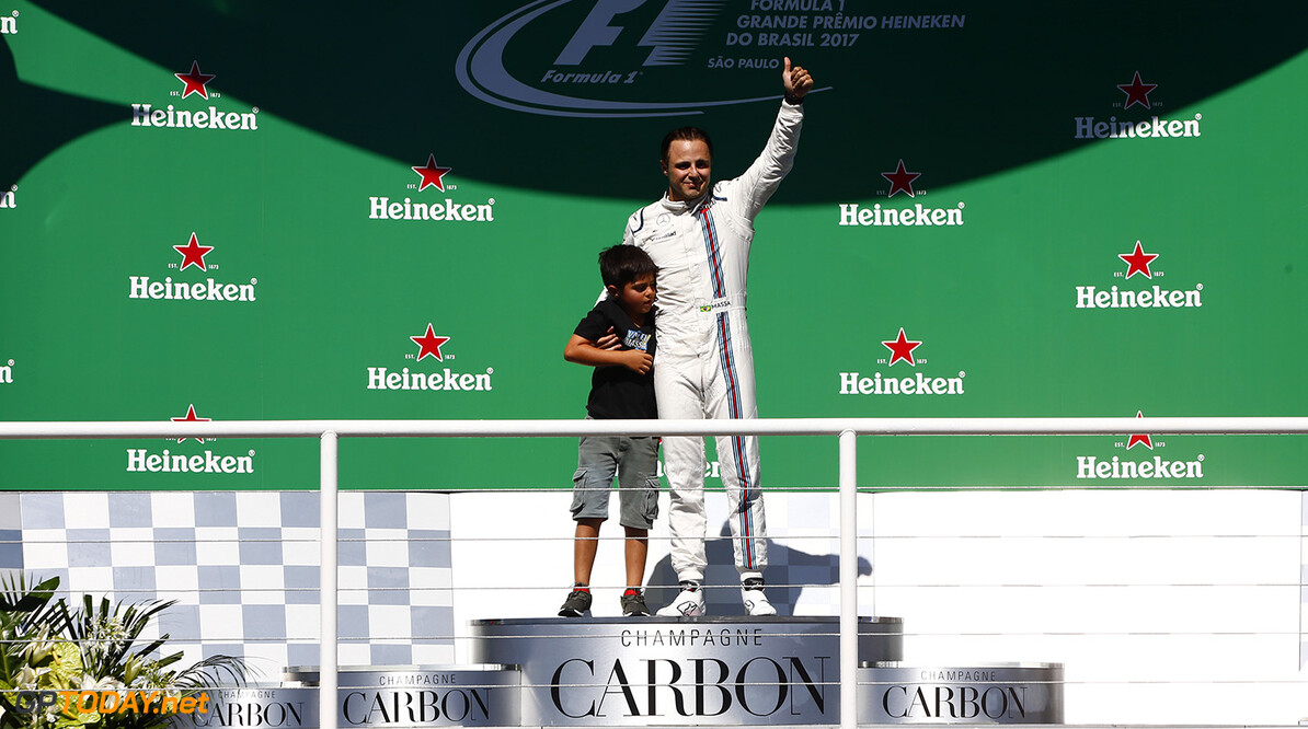 Interlagos, Sao Paulo, Brazil. Sunday 12 November 2017. Felipe Massa, Williams Martini Racing, on the podium after the race with his son Felipinho. Photo: Andrew Hone/Williams ref: Digital Image _ONY9561      f1 formula 1 formula one gp Portrait Atmosphere