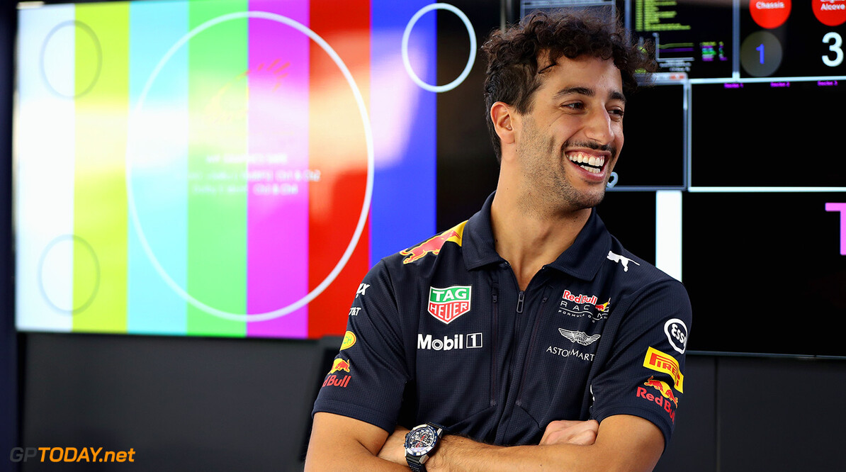 ABU DHABI, UNITED ARAB EMIRATES - NOVEMBER 23:  Daniel Ricciardo of Australia and Red Bull Racing laughs in the Red Bull Racing garage during previews for the Abu Dhabi Formula One Grand Prix at Yas Marina Circuit on November 23, 2017 in Abu Dhabi, United Arab Emirates.  (Photo by Mark Thompson/Getty Images) // Getty Images / Red Bull Content Pool  // P-20171123-00994 // Usage for editorial use only // Please go to www.redbullcontentpool.com for further information. //  F1 Grand Prix of Abu Dhabi - Previews Mark Thompson Abu Dhabi United Arab Emirates  P-20171123-00994