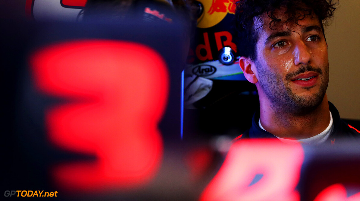 ABU DHABI, UNITED ARAB EMIRATES - NOVEMBER 24:  Daniel Ricciardo of Australia and Red Bull Racing talks with a Red Bull Racing team member in the garage during practice for the Abu Dhabi Formula One Grand Prix at Yas Marina Circuit on November 24, 2017 in Abu Dhabi, United Arab Emirates.  (Photo by Dan Istitene/Getty Images) // Getty Images / Red Bull Content Pool  // P-20171124-00748 // Usage for editorial use only // Please go to www.redbullcontentpool.com for further information. //  F1 Grand Prix of Abu Dhabi - Practice Dan Istitene Abu Dhabi United Arab Emirates  P-20171124-00748