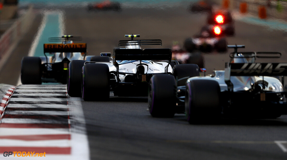 Yas Marina Circuit, Abu Dhabi, United Arab Emirates. Sunday 26 November 2017. Lance Stroll, Williams FW40 Mercedes, leads Romain Grosjean, Haas VF-17. Photo: Glenn Dunbar/Williams ref: Digital Image _X4I9361  Glenn Dunbar    f1 formula 1 formula one gp Action
