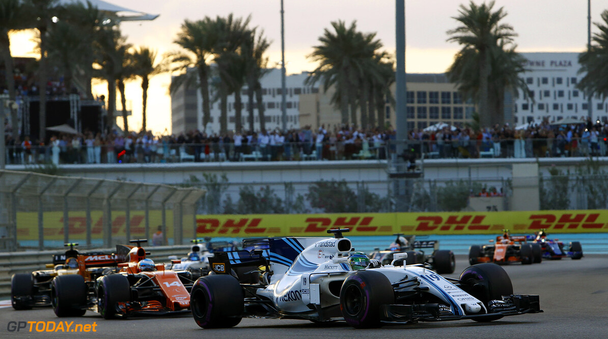 Yas Marina Circuit, Abu Dhabi, United Arab Emirates. Sunday 26 November 2017. Felipe Massa, Williams FW40 Mercedes, leads Fernando Alonso, McLaren MCL32 Honda. Photo: Steven Tee/Williams ref: Digital Image _O3I2799  Steven Tee    f1 formula 1 formula one gp Action
