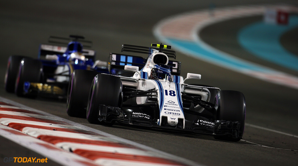 Yas Marina Circuit, Abu Dhabi, United Arab Emirates. Sunday 26 November 2017. Lance Stroll, Williams FW40 Mercedes, leads Marcus Ericsson, Sauber C36 Ferrari. Photo: Charles Coates/Williams ref: Digital Image DJ5R3397      f1 formula 1 formula one gp Action