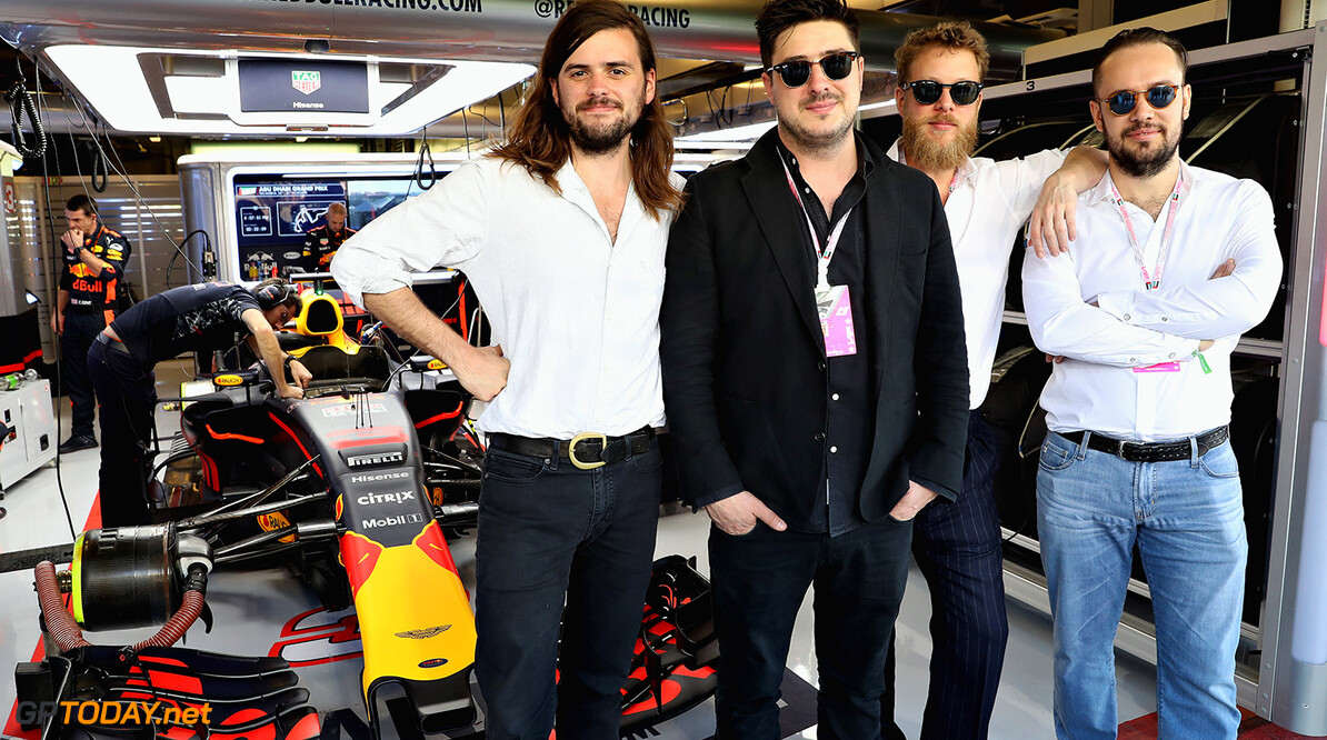 ABU DHABI, UNITED ARAB EMIRATES - NOVEMBER 26: Mumford and Sons pose for a photo outside the Red Bull Racing garage before the Abu Dhabi Formula One Grand Prix at Yas Marina Circuit on November 26, 2017 in Abu Dhabi, United Arab Emirates.  (Photo by Mark Thompson/Getty Images) // Getty Images / Red Bull Content Pool  // P-20171126-00290 // Usage for editorial use only // Please go to www.redbullcontentpool.com for further information. //  F1 Grand Prix of Abu Dhabi Mark Thompson Abu Dhabi United Arab Emirates  P-20171126-00290