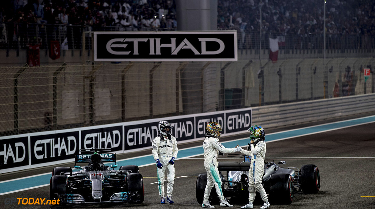 Yas Marina Circuit, Abu Dhabi, United Arab Emirates. Sunday 26 November 2017. Valtteri Bottas, Mercedes AMG, 1st Position, and Lewis Hamilton, Mercedes AMG, 2nd Position, shake hands with Felipe Massa, Williams Martini Racing, on the grid after his final race in F1. Photo: Glenn Dunbar/Williams ref: Digital Image _31I9287  Glenn Dunbar    f1 formula 1 formula one gp Portrait Helmets Finish