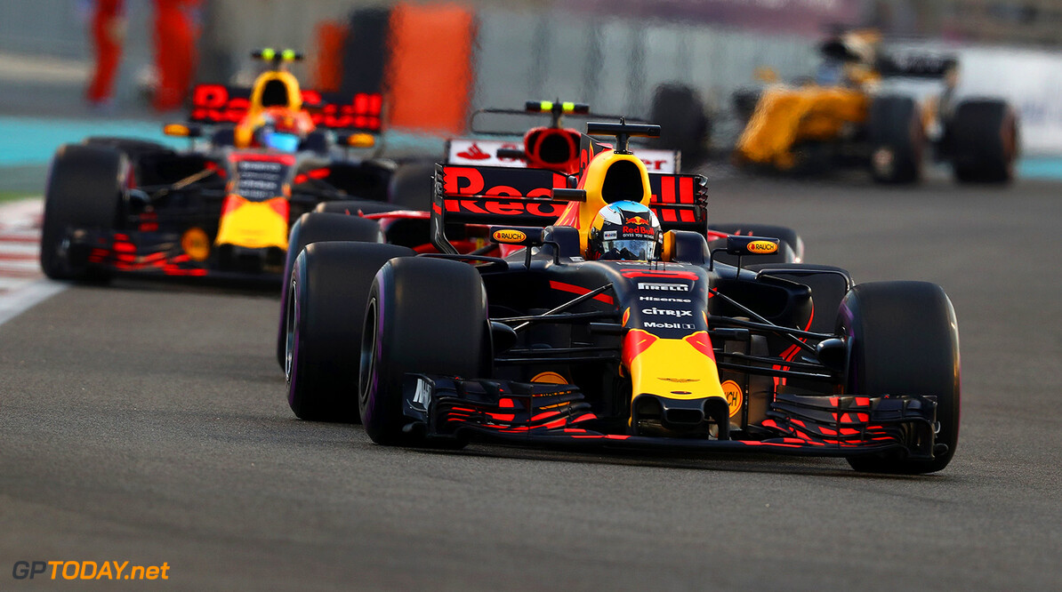 ABU DHABI, UNITED ARAB EMIRATES - NOVEMBER 26: Daniel Ricciardo of Australia driving the (3) Red Bull Racing Red Bull-TAG Heuer RB13 TAG Heuer leads Kimi Raikkonen of Finland driving the (7) Scuderia Ferrari SF70H and Max Verstappen of the Netherlands driving the (33) Red Bull Racing Red Bull-TAG Heuer RB13 TAG Heuer on track during the Abu Dhabi Formula One Grand Prix at Yas Marina Circuit on November 26, 2017 in Abu Dhabi, United Arab Emirates.  (Photo by Clive Mason/Getty Images) // Getty Images / Red Bull Content Pool  // P-20171126-00755 // Usage for editorial use only // Please go to www.redbullcontentpool.com for further information. //  F1 Grand Prix of Abu Dhabi Clive Mason Abu Dhabi United Arab Emirates  P-20171126-00755