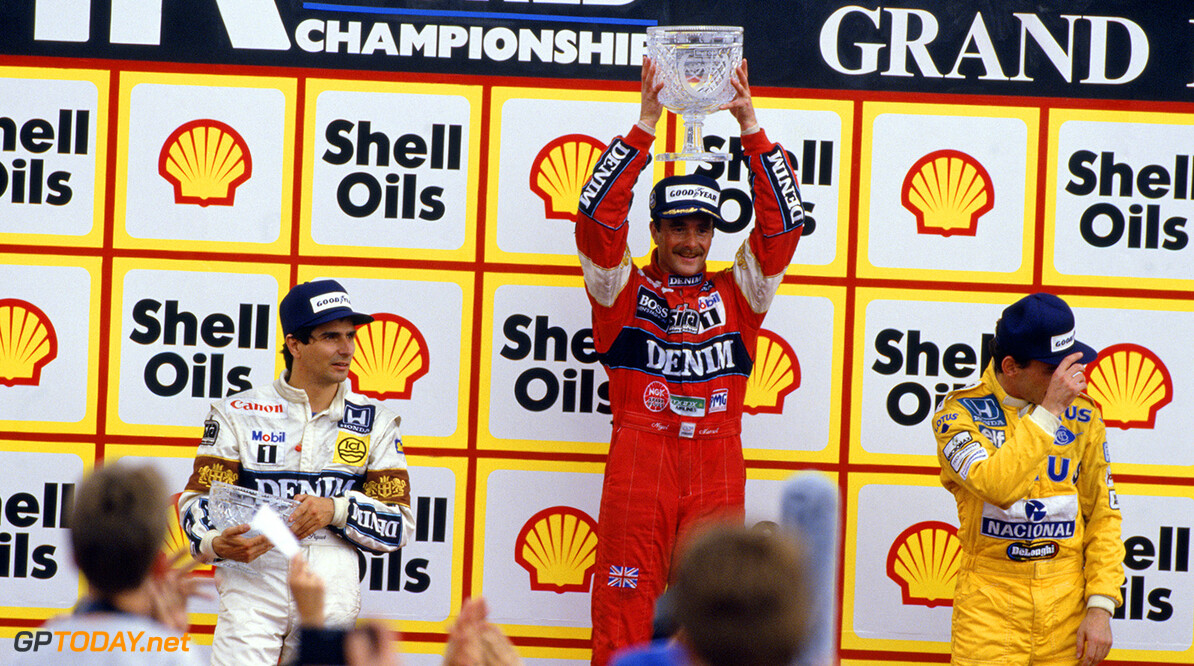 1987 British Grand Prix  Silverstone, England, 10th - 12th July 1987, RD7. Nigel Mansell stands on the top step of the podium for his home race, with team mate Nelson Piquet in 2nd and Ayrton Senna in 3rd. Portrait. Podium. Photo: LAT Photographic/Williams F1. Ref: 1987williams06