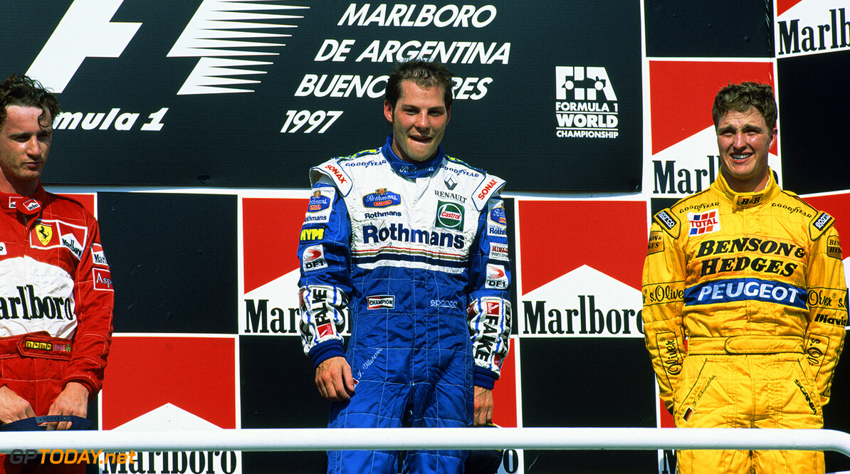 1997 Argentinian Grand Prix Buenos Aires, Argentina. 11th - 13th April 1997. Jacques Villeneuve (Williams FW19 Renault) celebrates on the podium. Photo: LAT Photographic/Williams F1 ref: 35mm Transparency 1997Williams22