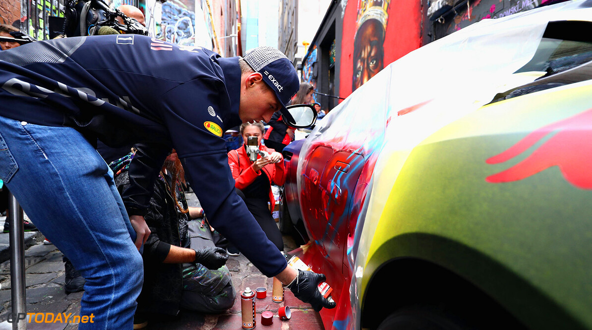 MELBOURNE, AUSTRALIA - MARCH 21:  Max Verstappen of Netherlands and Red Bull Racing  paints an Aston Martin with street artist Bryan Itch at an Aston Martin Red Bull Racing media call during previews ahead of the Australian Formula One Grand Prix at Albert Park on March 21, 2018 in Melbourne, Australia.  (Photo by Mark Thompson/Getty Images) // Getty Images / Red Bull Content Pool  // AP-1V468SA1D1W11 // Usage for editorial use only // Please go to www.redbullcontentpool.com for further information. //  Australian F1 Grand Prix - Previews  Melbourne Australia  AP-1V468SA1D1W11