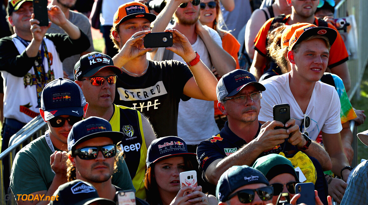 MELBOURNE, AUSTRALIA - MARCH 22: Red Bull Racing fans take photos of the drivers on the autograph stage during previews ahead of the Australian Formula One Grand Prix at Albert Park on March 22, 2018 in Melbourne, Australia.  (Photo by Mark Thompson/Getty Images) // Getty Images / Red Bull Content Pool  // AP-1V4H4PBYS1W11 // Usage for editorial use only // Please go to www.redbullcontentpool.com for further information. //  Australian F1 Grand Prix - Previews Mark Thompson Melbourne Australia  AP-1V4H4PBYS1W11