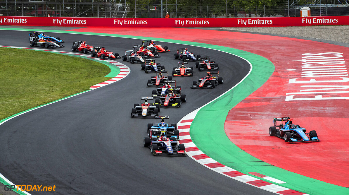 2018 GP3 Series Round 1.  Circuit de Catalunya, Barcelona, Spain. Sunday 13 May 2018. Giuliano Alesi (FRA, Trident), leads Juan Manuel Correa (USA, Jenzer Motorsport) and the rest of the field at the start of the race. Photo: Zak Mauger / GP3 Series Media Service. ref: Digital Image _54I2967   Zak Mauger    Race Two 2 action start