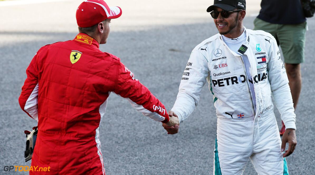 Vettel en Hamilton hebben uit respect hun helmen uitgewisseld