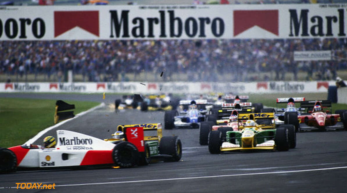 1992 French GP CIRCUIT DE NEVERS MAGNY-COURS, FRANCE - JULY 05: Michael Schumacher, Benetton B192 Ford, collides with Ayrton Senna, McLaren MP4-7A Honda, at the Adelaide hairpin on the first lap during the French GP at Circuit de Nevers Magny-Cours on July 05, 1992 in Circuit de Nevers Magny-Cours, France. (Photo by Rainer Schlegelmilch) 1992 French GP Rainer Schlegelmilch  France  Action crash formula 1 f1