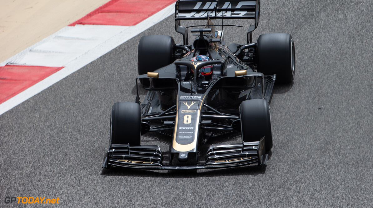 Grosjean sets morning pace as rain interrupts running