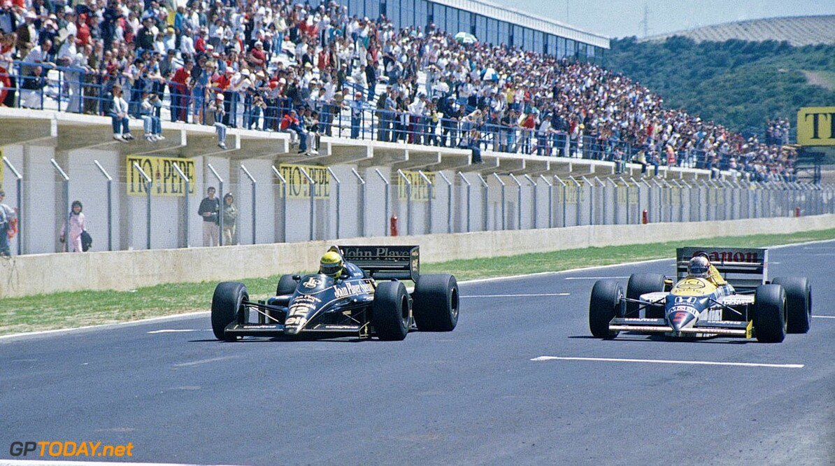 1986 Spanish Grand Prix  Jerez, Spain, 11th - 13th April 1986, RD2. Nigel Mansell, Williams FW11-Honda, charges for the line alongside Ayrton Senna, Lotus 98T-Renault. Mansell finished 2nd to Senna with just 0.014 seconds behind. Action. Finish. Photo: LAT Photographic/Williams F1. Ref: 1986williams08