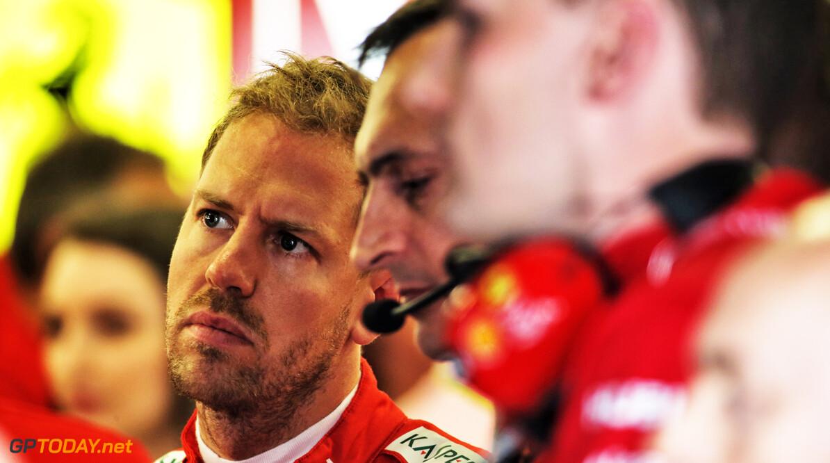 Vettel plays down Ferrari's gap over Mercedes